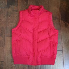 Gap Red Puffer Vest Gap Red Puffer Vest  Color: Red  Material: 100% Polyester  ❗️Does not come with the fur around hoodie❗️  Measurements: 23 inches from Top ⬇️ Bottom  Armpit ➡️ Armpit: 19 1/2 Inches Great Condition  Open to offers  ❌No trades❌ GAP Jackets & Coats Vests