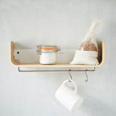 Universal Expert Beech Wood Shelf: Beautifully useful. The Universal Expert Beech Wood Shelf can be used anywhere in the home. Sturdy enough to store jars, bottles, books and other odds and ends, it also features a stainless steel hanging rail to store your kitchen towels.