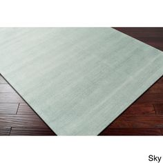 Hand-loomed Tatum Solid Wool Area Rug (9' x 13')