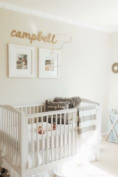 A sweet all-white nursery with a touch of charcoal gray