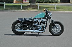Harley Davidson Sportster 48 with Biltwell mustache handlebars, La Pera solo seat, Easy Riders rear fender and Supertrapp exhaust Sportster Cafe Racer, Sportster 48, Sportster Motorcycle, Custom Sportster, Custom Harleys, Custom Bikes, Motorcycle Baby, Retro Motorcycle, Hd Motorcycles