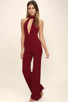 Lulus Exclusive! Channel your inner '70s diva in the You Light Up My Life Wine Red Jumpsuit! A mock neck and sexy front and back cutouts top the princess seamed, sleeveless bodice of this chic jumpsuit. A fitted waist, and wide-leg pants complete the look. Hidden back zipper.