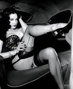 Dita von Teese.  black corset stockings seams heels