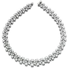 DIAMOND NECKLACE. Designed as a graduated line of marquise-shaped and brilliant-cut diamonds, mounted in platinum, length approximately 410mm.