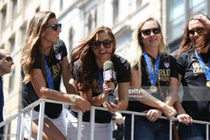 Soccer player Alex Morgan (2nd L) rides a float with fellow team members during a Ticker Tape Parade for World Cup Champions U.S. Women's Soccer National Team on July 10, 2015 in New York City.