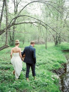 Spring wedding along river in Wisconsin Photo by Emily Steffen