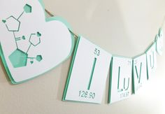 5 Foot Periodic Table of Elements- I Luv U Banner- Cool Mint, Hot Pink, Red, Purple- Bunting Flag- Valentines Day Anniversary. $19.95, via Etsy.