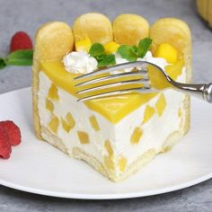 This photo shows a piece of Mango Charlotte Cake served on a plate with fresh ra. - This photo shows a piece of Mango Charlotte Cake served on a plate with fresh raspberries and mint - Mango Cheesecake, Cheesecake Recipes, Make Ahead Desserts, No Bake Desserts, Easy Desserts, Dessert Recipes, Recipes Dinner, Oreo Dessert, Puddings