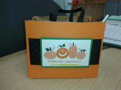 Halloween Treat Bag is a decorated brown paper bag.