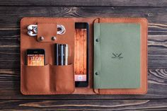 iPad and document organizer. iPad mini leather folio brown color. Cut and pierced by hands. Moreover, it's sewn by hands but not with a machine, what