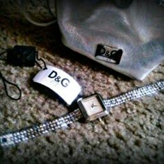 D&G Silver watch Dolce & Gabbana Time watch light scratches & needs a new battery other than that in good condition come with orginal bag, tag, and extra links. Dolce & Gabbana Accessories Watches