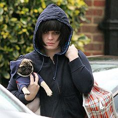 With her precious pug Prudence snuggled up in a matching hoodie, Kelly Osbourne takes a somber stroll