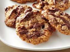 Monster Marshmallow Cookies : These fully-loaded cookies are packed with mini marshmallows, chocolate chips, crispy rice cereal and pecans and are topped with even more marshmallows and chocolate chips.
