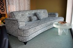 """Fabulous 1950's Style Dog Bone sofa in neutral Charcoal-black and white  textural fabric with Charcoal-black Barkcloth.  Great button details. Dimensions are 8' L x 3' deep x 30"""" H; seat height is 16""""."""
