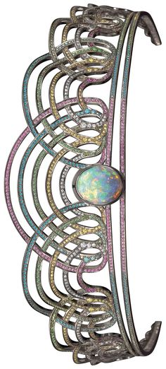High resolution image of the RAINBOW TIARA by Solange Azagury-Partridge. An open work tiara set with an oval black Opal surrounded by tiers of Diamonds and precious stones in blackened 18ct white gold.