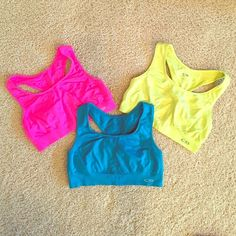 Champion Seamless L Compression Sports Bras Bundle Champion Seamless L Compression Racerback Sports Bras Bundle! Electric Hot Pink, Electric Blue, and Electric Yellow. So Comfortable! Ready to be Debuted at Your Gym!  Please comment about buying separately if not interested in bundling! Champion Intimates & Sleepwear Bras