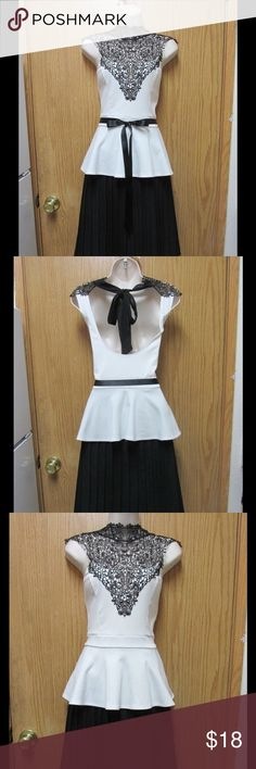 Glamorous Ivory Peplum Top W/Black Lace Neck &Belt This top is really cute and adorable. Soft and comfy. Stretchy material. Belt included. Gorgeous colors and exclusive design. Size XL- Very good condition. Save $$$ on bundles. Tops Blouses