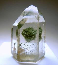 Quartz with chlorite inclusions.A terrific purification stone, great to cleanse blockages of the heart. Assists in dissipating anger and resentment around the heart chakra. In a personal space or practice, it is also good to clear negativity out of an area.