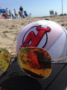 Twitter fan @DWillx23 shows off his New Jersey Devils #NHLDraft Hat at the beach. #IsItOctoberYet?