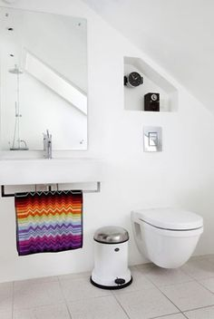 Swiss house with a Nordic touch. White, simple bathroom.