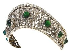 Emerald and Diamond Tiara, made by Bolin, of Queen Marie of Yugoslavia, the history of these Romanov emeralds. From 1908, the emerald parure of Grand Duchess Elisabeth Feodorovna was in the possession of Maria Pavlovna the younger. When she was in exile in Romania, after the Russian Revolution, the Grand Duchess sold the emerald tiara and the necklace to King Alexander I of Serbia (1888-1934) who purchased them as a wedding gift for his bride Princess Maria of Romania (1900-1961).