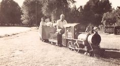 William Harrison Kennedy conducting the Kern River Railroad, a miniature train that used to travel around Hart Park. c.1940s