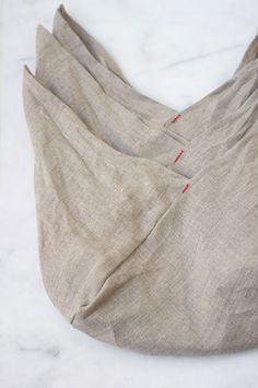 Linen wrapping cloths - shaped to hold small items such as snacks or small purse items. Just tie two flaps.