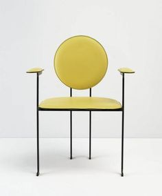 The design of this head-turning dining armchair is based on the tilting backrest introduced by Le Corbusier. It is named mm3 is honor of the master. The wooden sphere on the back allows one to move the chair with ease.