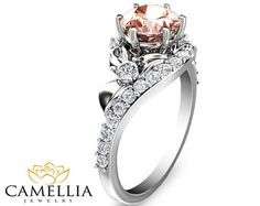 This captivatingflower morganite engagement ring makes an amazing gift for the woman in your life whether a wife, friend or mother. It features a diamond encrusted rose gold band with an intricately designed flower with natural morganitecenter. This unique ring is the perfect balance of style and grace. It can be worn as a modern fashion statement or as a promise ring for the life that is yet to come. This is a limited edition Camellia Jewelry original. Order now to guarantee availability…