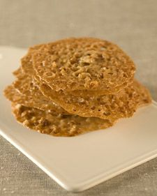 These crunchy cookies are wonderful on their own or when paired with your favorite ice cream. If you like, you can substitute almonds for the pecans and lemon zest for the orange zest. Or make a sandwich by spreading a layer of melted chocolate between two cookies.