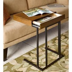 The Wynn pull up table focuses on utility and functionality, while providing simple style to any living room. The table is easy to move around with an inner storage compartment, perfect for your laptop or magazines. Pull it up to your favorite seat, as this multifunctional piece can work as a simple snack table or work desk. Featured in a pecan wood finish. Assembly required.