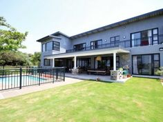 An exclusive, exquisite and tastefully designed family home with superb sea views is situated in prestigious road in Simbithi Golf Estate. 5 spacious bedrooms, all en-suite, fully equipped gym, private study, pool, children's playroom, state of the art kitchen, guest loo. This home is Smart Home Wired with a full multimedia system, all iPad controlled.