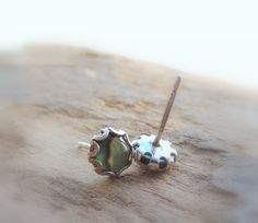 A personal favorite from my Etsy shop https://www.etsy.com/listing/502322607/sterling-silver-abalone-stud-earrings