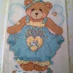 A teddy bear cross stitch.