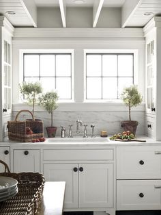 adorable kitchen....marble, baskets, plants, and lots of light.    061411_Kitchen-Greenery by kristin kerr, via Flickr
