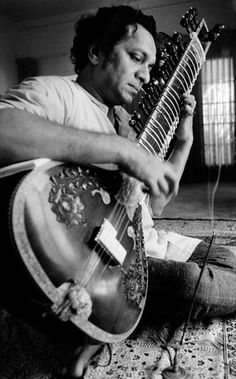 In this 1967 file photo, Ravi Shankar plays his sitar in Los Angeles. Shankar, the sitar virtuoso who became a hippie musical icon of the 1960s after hobnobbing with the Beatles and who introduced traditional Indian ragas to Western audiences over an eight-decade career, died Tuesday, Dec. 11, 2012. He was 92. (AP Photo, File)