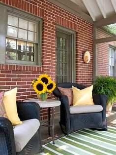 The porch addition is located right off the kitchen, perfectly suited for a breakfast room or to host small gatherings. Coal-black all-weather wicker furniture with indoor-outdoor cushions matches the homes casual cottage style -- making it an extension of the indoor living spaces.