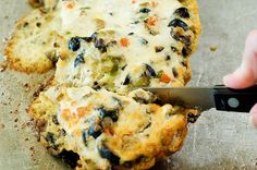 Mmmmm, this is yummy. Three or four years ago, I prepared roasted beef tenderloin, tomato-basil pasta salad, roasted asparagus, and this olive cheese bread for a cattlewomen's luncheon with o…