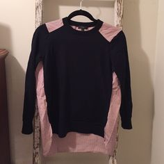 "JCrew sweater with fun ""shirt"" back JCrew navy wool sweater in front with a cute Oxford type shirt in back. Purchased for my daughter who wore it just a few times. It's practically new! Size small. J. Crew Sweaters Crew & Scoop Necks"