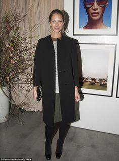 Christy Turlington Burns looked conservative in her choice of attire - which included a navy blue suit jacket