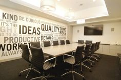 Inspiring Picture of Cool Conference Room Ideas : Inspiring Conference Room With Grey Rectangular Table And Black Conference Chairs Also Words Decoration On Wall Along With Wall Mounted Black LCD Television Also Triple Glass Pendant Lamp
