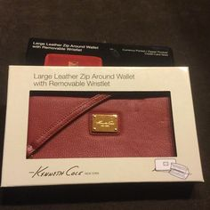 Large leather zip around wallet 3 available $10 until tomorrow  Large red leather zip around wallet with removable wristlet. Includes 12 card slots, Bill slot, zippered middle for change and large enough for your phone.  Do not buy this listing, i will make a separate listing so you can get the shipping discount  NO TRADE  3 available Kenneth Cole Bags Wallets