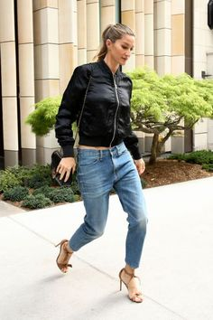 boyfriend jeans with a black bomber jacket and strappy heels