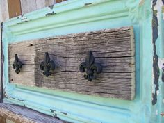 I just love the use of old ceiling tiles and barnwood. This would be cute outside for pool towels to hang from.