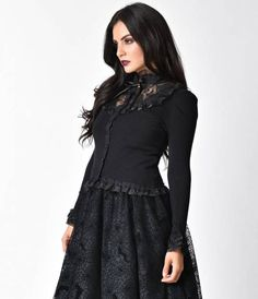 Mysterious and marvelous, the Rose Cardigan from Banned is an all black and lace knit stunner in a 1950s retro silhouette with a dash of Victorian verve. A button up front is offset by long sleeves, each cuffed with ruffled layers of frilly lace and sheen
