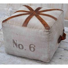 N0 6 SQUARE OTTOMAN  A modernised Union Jack emblem made from distressed leather against the cool toned canvas features on our No 6 Square Ottoman. Contemporary sheik design that won't going out of style anytime soon!