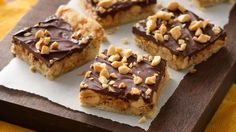 Chocolate-Toffee-Peanut Butter Crunch Bars- Five simple ingredients turn Pillsbury sugar cookies into extraordinary bars.