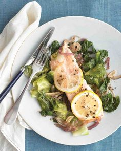 Top salmon fillets with lemon slices and cook upon a bed of escarole, garlic, and red onion in a pot on the stovetop for a one-dish meal that is ready in just 35 minutes.