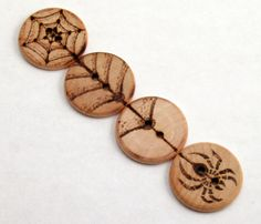 This really neat set of buttons come together to form a web and spider. Use them buttoned down on a sweater, vest or jacket, or in another