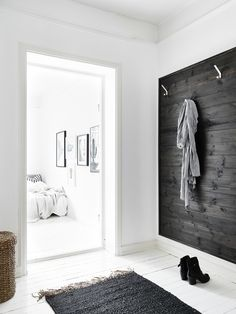 entry with black stained wooden wall